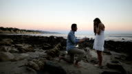 Multi-Ethnic Romantic Couple Proposing at the Beach
