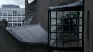 A multi-framed window juts out from a wall on the Glasgow School of Art, Scotland. Available in HD.