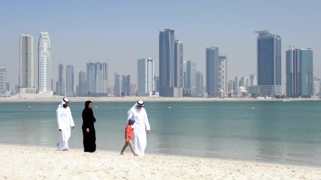 Multi-generation Emirati family on the beach