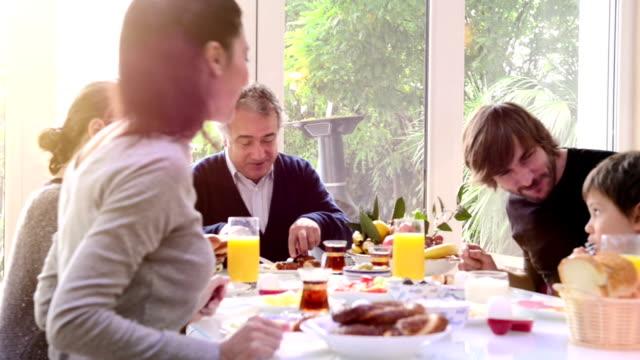 Multi-generation Turkish family having breakfast