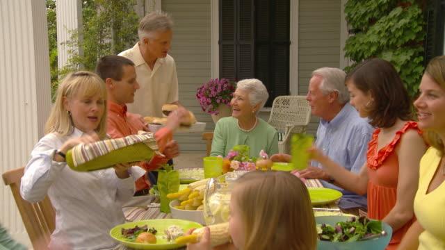 ZI MS Multigenerational family having picnic at outdoor table / Richmond, Virginia