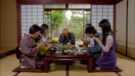 Multigenerational family starting dinner/ Tokyo, Japan
