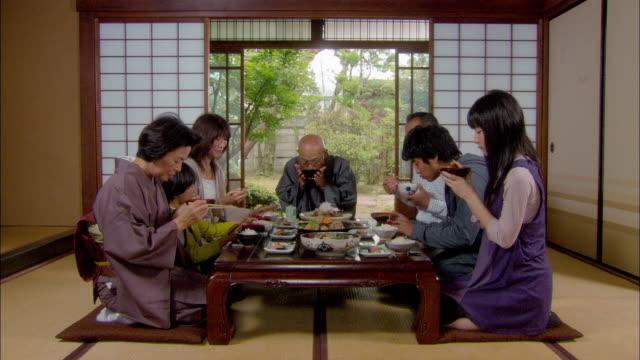 Multigenerational family starting dinner/ Tokyo, Japan
