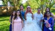 MS ZI ZO Multigenerational female family members posing for quinceanera photos in backyard