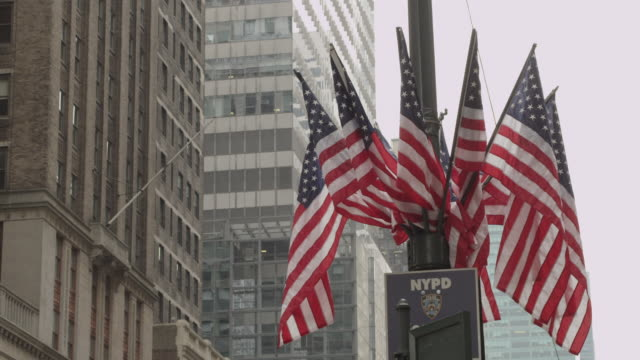 Multiple American flags blow in the wind in Manhattan