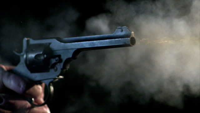 Multiple close up shots of a gun firing in slow motion