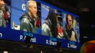 Multiple shots of the jumbotron showing players being interviewed at the Super Bowl Media Day at the Prudential Center in Newark New Jersey on...