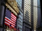 Multiple US flags hung on federal reserve building