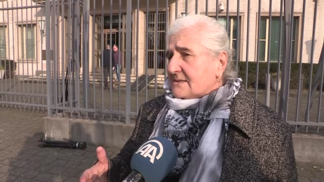 Munira Subasic President of the Association of Movement of Mothers of Srebrenica and Zepa Enclaves and Bosnians speak to the media outside a court...
