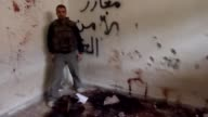 Murad Hakura a captive of the Syrian military showED an AFP reporter the former cultural centre of Maaret alNuman which he purports was converted by...