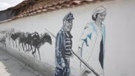 Mural depicting symbolising Brexit shows UK PM Theresa May along with a local shepard is seen on a wall as part of Mural Festival in the village of...