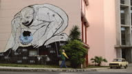 MS A mural depicts corporations devouring the world / Havana, Cuba