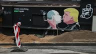 A mural depicts US Presidentelect Donald Trump blowing marijuana smoke into the mouth of Russian President Vladimir Putin on the wall of a barbque...