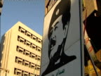 A mural of Saddam Hussein hangs from a building in Baghdad.