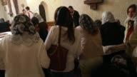 WS Murat Uzel leads prayer while blessing the faithful at the conclusion of Mass at the St Jacob Syrian Orthodox Antioch Church on Assumption Day on...