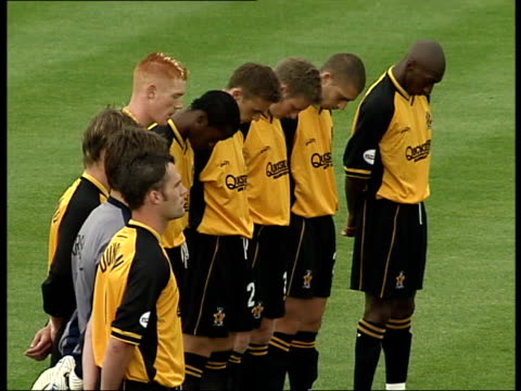 Holly Wells/Jessica Chapman Minutes silence ITN ENGLAND Cambridgeshire Cambridge Abbey Stadium Cambridge United and Leyton Orient players out onto...