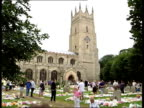 Holly Wells/Jessica Chapman Minutes silence ITN Cambridgeshire Soham Clock on St Andrews Church at 3 o'clock PULL OUT people in churchyard standing...