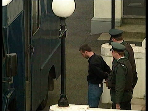 IRA murder trial ITN Belfast TLMS SLOMO Michael McGinn led along by prison officers to van ZOOM IN i/c