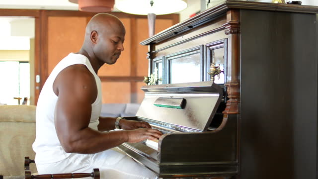 Muscular African piano player