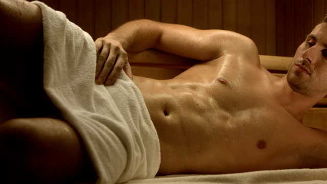 HD DOLLY: Muscular Man Relaxing In The Sauna