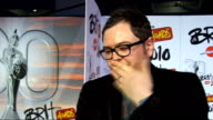 2010 Brit Awards red carpet arrivals Alan Carr interview SOT On Peter Kay presenting / last year he accidentally spat on Kylie / Robbie Williams /...