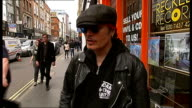 Adam Ant interview on Record Store Day Reckless Records EXT Sign 'Reckless Records' / Adam Ant along street and shaking hands with reporter / Adam...