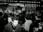 Bill Haley arrives in Britain ENGLAND Southampton EXT Queen Elizabeth at docks / Bill Haley away inside car / Crowds of Bill Haley fans with flags...