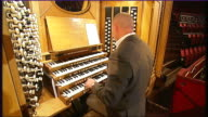 Composer Nitin Sawnhey concert features Willis Organ ENGLAND London Royal Albert Hall INT James Taylor playing Channel 4 News theme tune on Willis...