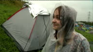 Glastonbury Festival Tents and festivalgoers in the rain ENGLAND Somerset Glastonbury General views of tents and festivalgoers milling about / vox...
