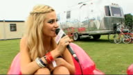 Isle of Wight Festival interviews EXT Festivalgoers wearing funny sunglasses ** music overlaid SOT ** Pixie Lott interview SOT Her first time at the...