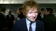 Ivor Novello Awards 2012 celebrity interviews Ed Sheeran speaking to press Ed Sheeran interview SOT On his suit / flying economy and saving his money...