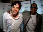 JayZ's O2 Wireless afterparty arrivals *** FLASH JayZ arriving with Mark Ronson posing for photocall ENDS