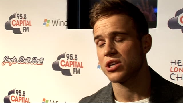 Jingle Bell Ball at 02 Arena backstage interviews Olly Murs talking to press Murs interview SOT On being an X Factor fan / On still seeing his old X...