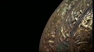 INT * * Music overlay SOT * * Various close ups of gold Anglo Saxon artefacts ENDs