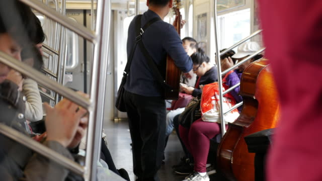 Music performer on the New York subway train
