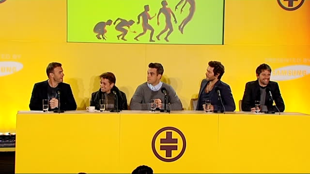 Take That press conference ENGLAND London Savoy Hotel INT Take That along to press conference SOT / Robbie Williams smiling Take That press...