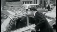Preview of Andrew Lloyd Webber musical 'Stephen Ward' LIB July 1963 London EXT Stephen Ward along and into car London Airport Mandy RiceDavies at...