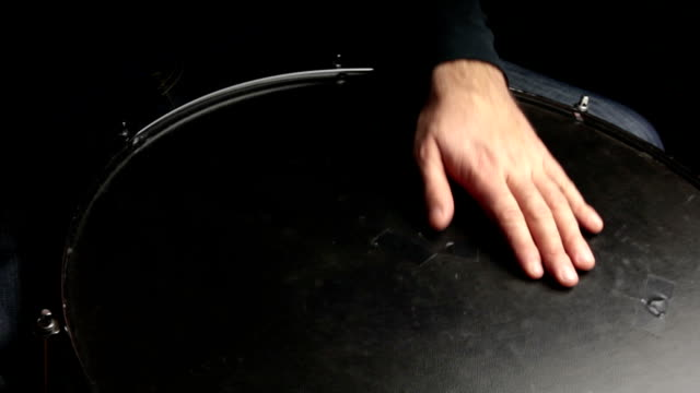 musician plays a rhythm with the surdo drum, percussion instrument