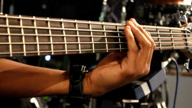 PAN CU Musician's hands on bass guitar / Johannesburg/ South Africa