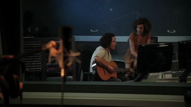 Musicians in recording studio