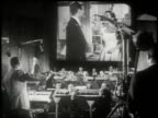 1951 MONTAGE musicians orchestrating background music for the film on the scoring stage