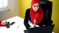 Muslim female science working.