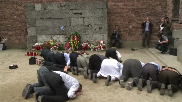 Muslim leaders from across the globe knelt in prayer for the Holocaust dead at the Auschwitzs notorious Wall of Death on Wednesday in an emotional...