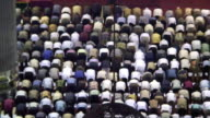HA WS ZO Muslim men bowing and praying in Istiqlal Mosque / Jakarta, Indonesia