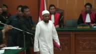 A Muslim militant arrested in the same Pakistani town where US commandos later killed Osama bin Laden stood trial in Indonesia Monday on charges...