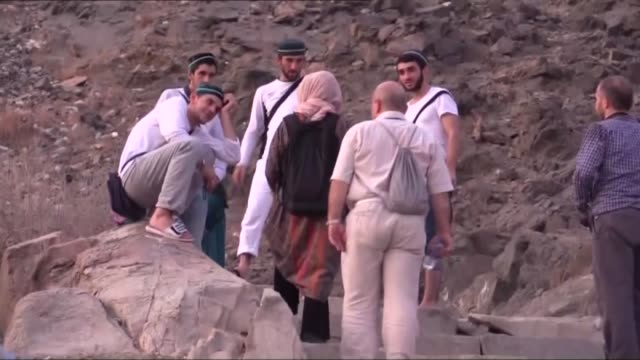 Muslim prospective pilgrims climb to the top of Jabal Thawr housing a cave known as Ghar alThawr where the Islamic Prophet Muhammad and his companion...