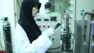 Muslim sciecne working in factory