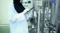Muslim sciecne working with digital tablet