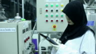 Muslim Scientist working at laboratory
