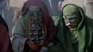 MS ZI CU PAN RECREATION Muslim women smelling spices at market / Iran